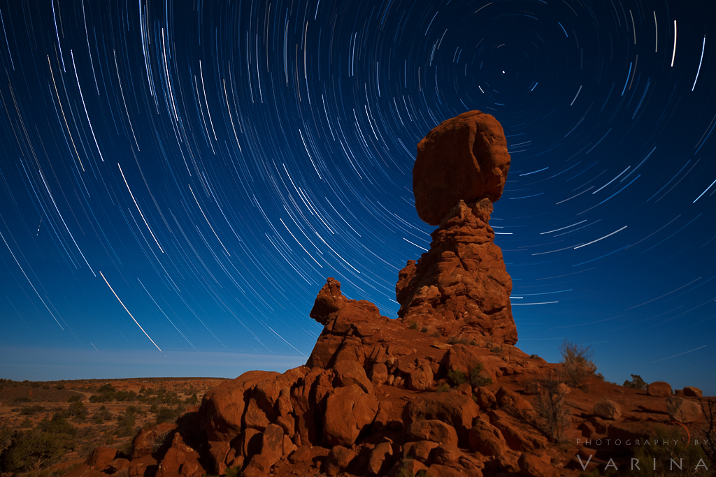 Photo stacked star trail photo from Arches National Park in Utah using multiple camera exposures by Varina Patel