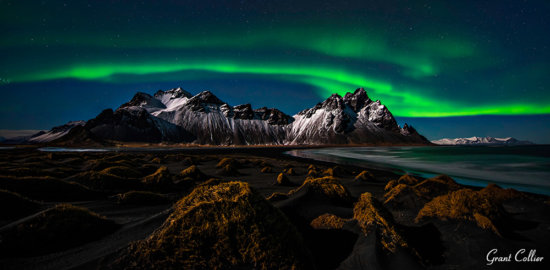 Night photography of Northern Light at Vesturhorn Mountain in Iceland by Grant Collier