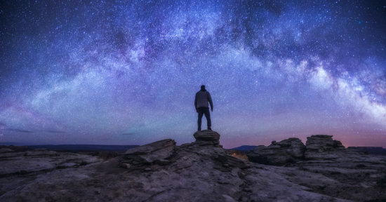 Night photography self portrait under starry skies by Peter Coskun