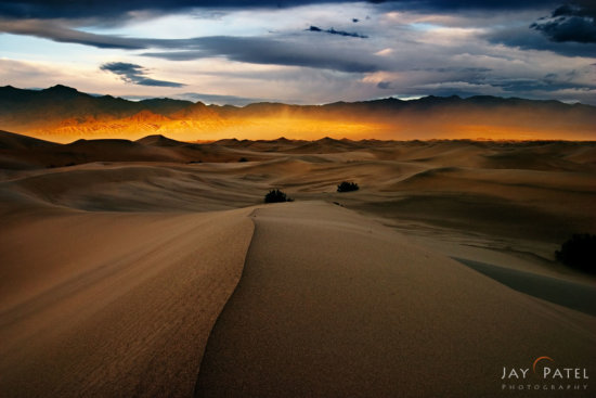 Storm light in landscape photography at Mesquite Dunes, Death Valley, California by Jay Patel