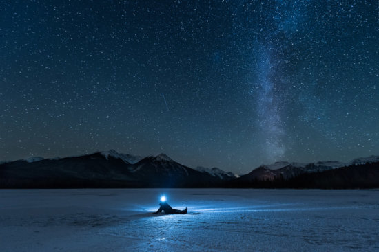 Lying on a frozen lake staring deep into space.