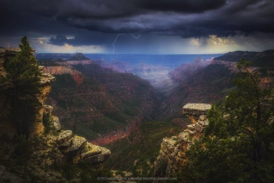 Lightning strikes the south rim of the grand canyon as seen from a remote viewpoint on the canyons north rim.