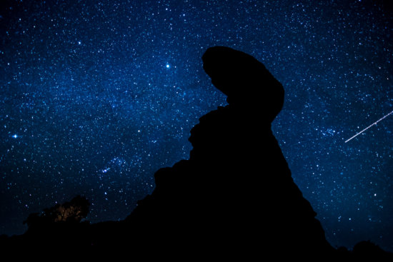 Night Photography of stars without moonlight at balanced Rock, Arches NP