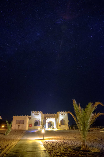 Night photography of stars with foreground light by artificial light at 1000 Nights Desert Camp, Sharqiya Sands, Oman