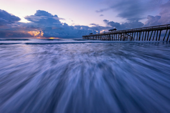 Flowing water of rushing waves captured using a sturdy tripod at Amelia Island, Florida by Kate Silvia