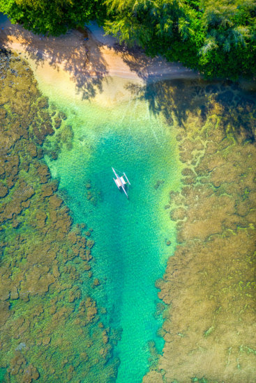 Midday drone photography to capture stunning colors in water by Lace Andersen