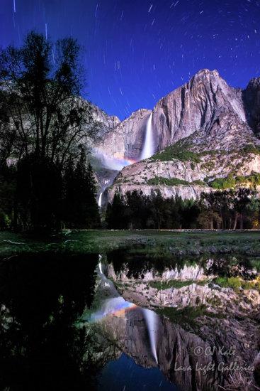 Star trails and moonbow at Yosemite Falls, Yosemite National Park, California