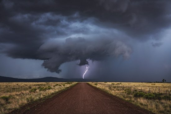 Nature photography during a lightning storm over northern Arizona by Peter Coskun.