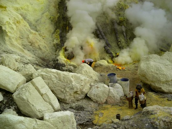 Travel Photography of sulfur miners at Kawah Ijen, Indonesia by Jessy Eykendorp