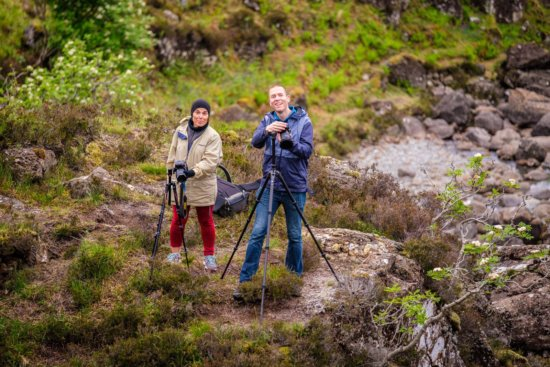 Landscape photographers using their tripods by Ugo Cei