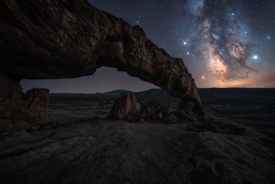 The Milky Way Night Photography over an arch outside of Escalante, Utah by Austin Jackson