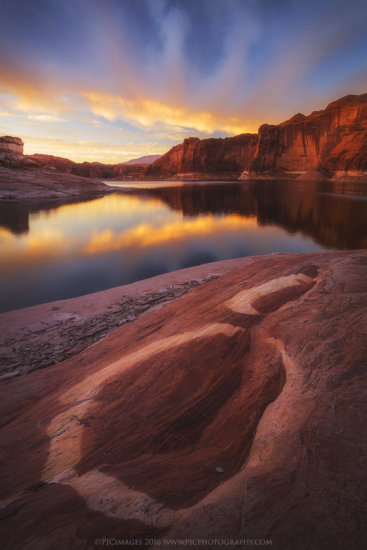 Sunrise over remote landscape photography location of Lake Powell, Arizona by Peter Coskun