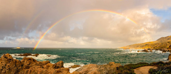 Panoramic photography composition with double rainbow by Jane Palmer