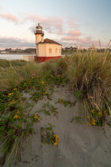 1/8 second shutter speed to freeze motion of the grass at Coquille Lighthouse in Bandon, Oregon by Jane Palmer